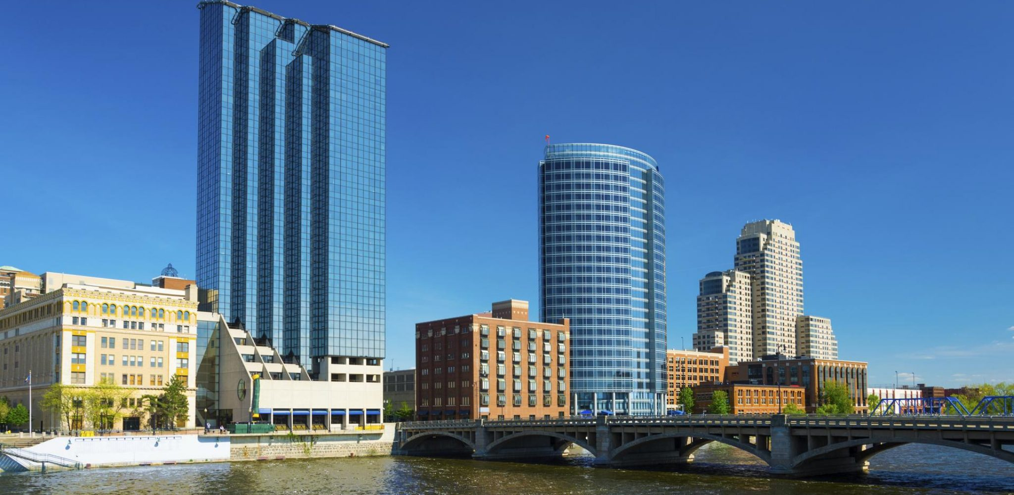 Grand Rapids downtown skyline with Grand River in the foreground.